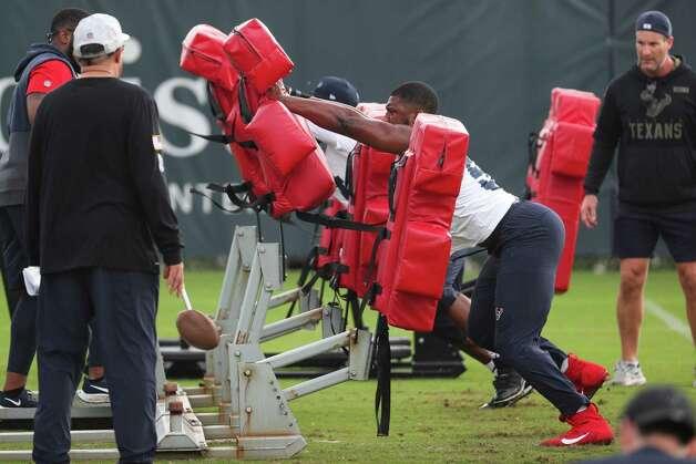Houston Texans linebacker Jonathan Greenard hits the blocking sled during team OTAs on Thursday, May 27, 2021, at The Houston Methodist Training Center in Houston. Photo: Brett Coomer, Staff Photographer / © 2021 Houston Chronicle