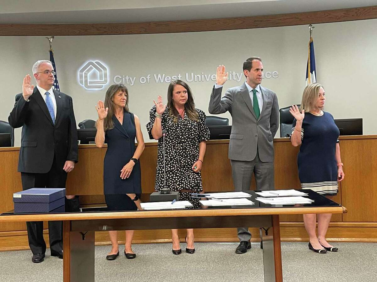 The new West University Place City Council (left to right: council members John Barnes, Melanie Bell, Shannon Carroll and John Montgomery and mayor Susan Sample) were sworn in during a special meeting on May 26