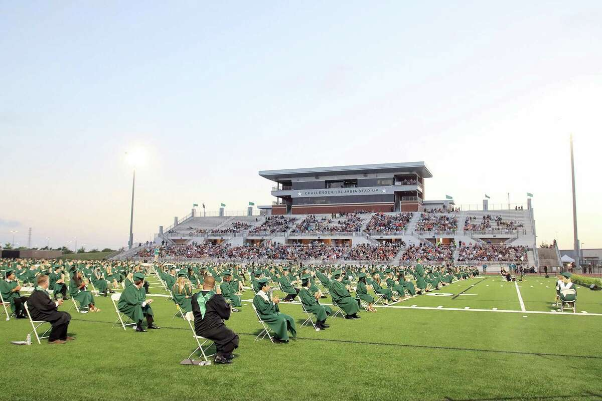 Graduating Clear Falls High School students sit across the field at Challenger Columba Stadium.