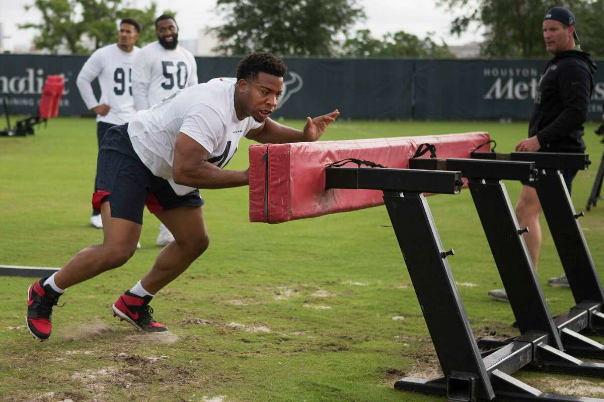 DeMarcus Walker, seen here at May's organized team activities, was activated from the active/non-football injury list.