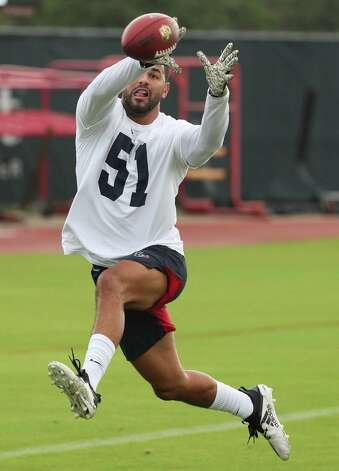 Houston Texans linebacker Kamu Grungier-Hill leaps to make a catch during team OTAs on Thursday, May 27, 2021, at The Houston Methodist Training Center in Houston. Photo: Brett Coomer, Staff Photographer / © 2021 Houston Chronicle