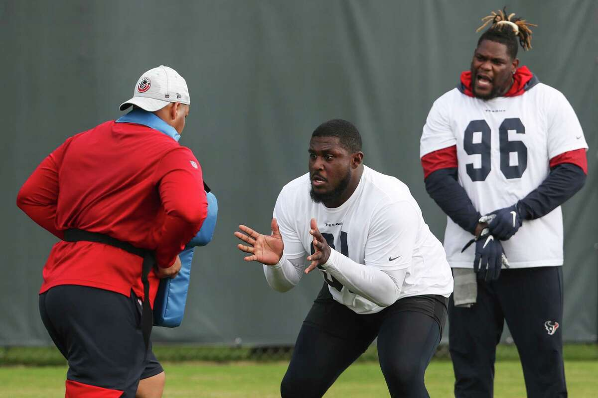 Houston Texans defensive lineman Jaleel Johnson (91) and Vincent Taylor (96) work out during team OTAs on Thursday, May 27, 2021, The Houston Methodist Training Center in Houston.
