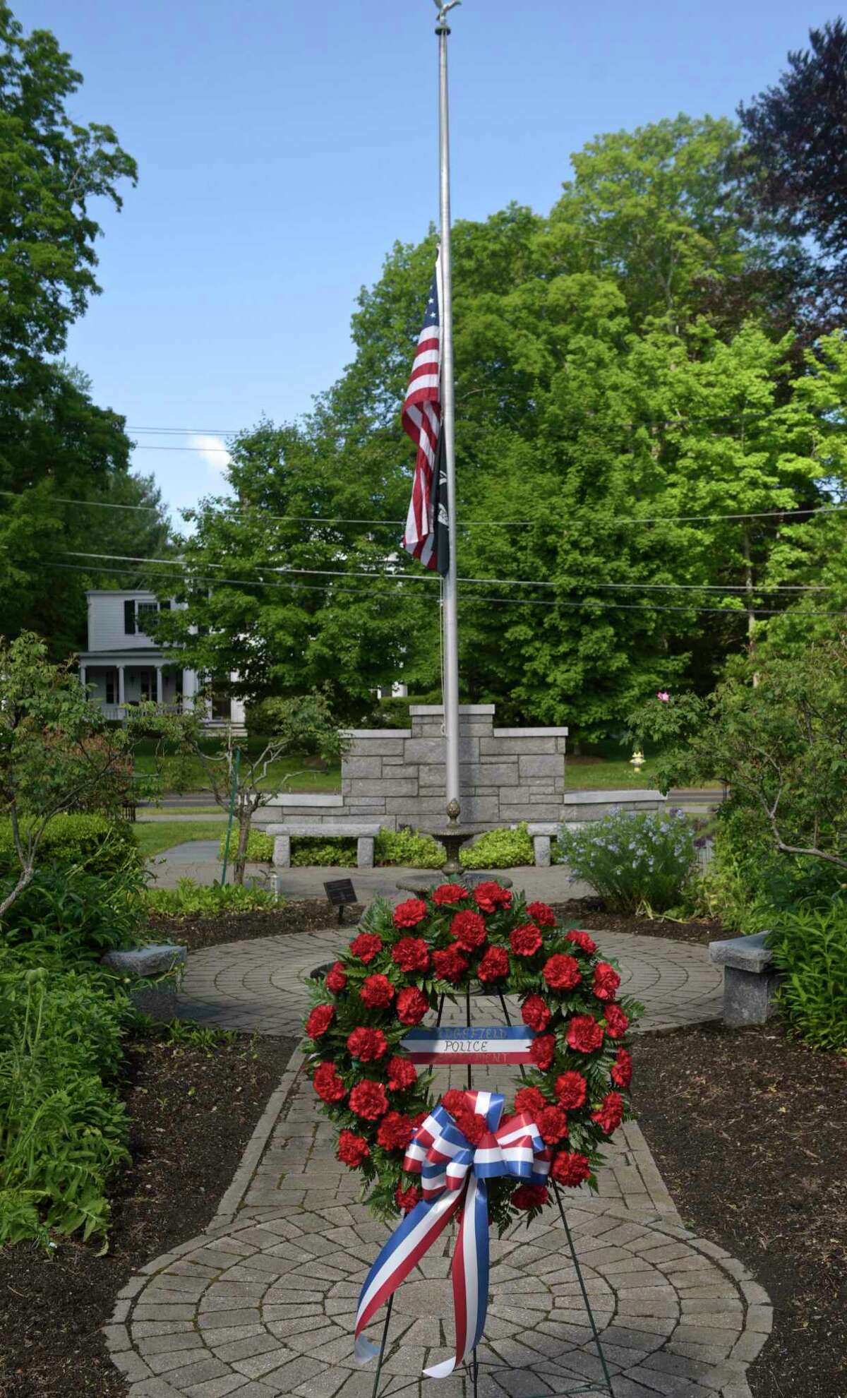 The Ridgefield Police Department held their annual Memorial Ceremony to honor and pay tribute to deceased members of the department. At the Lounsbury House, in Ridgefield, Conn, Thursday, May 27, 2021.