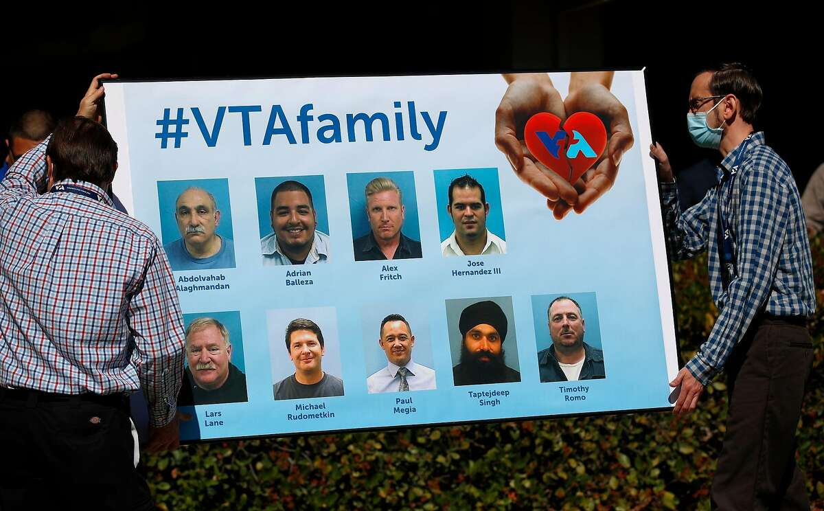 Valley Transportation Authority employees place a billboard memorializing victims of Wednesday's mass shooting.