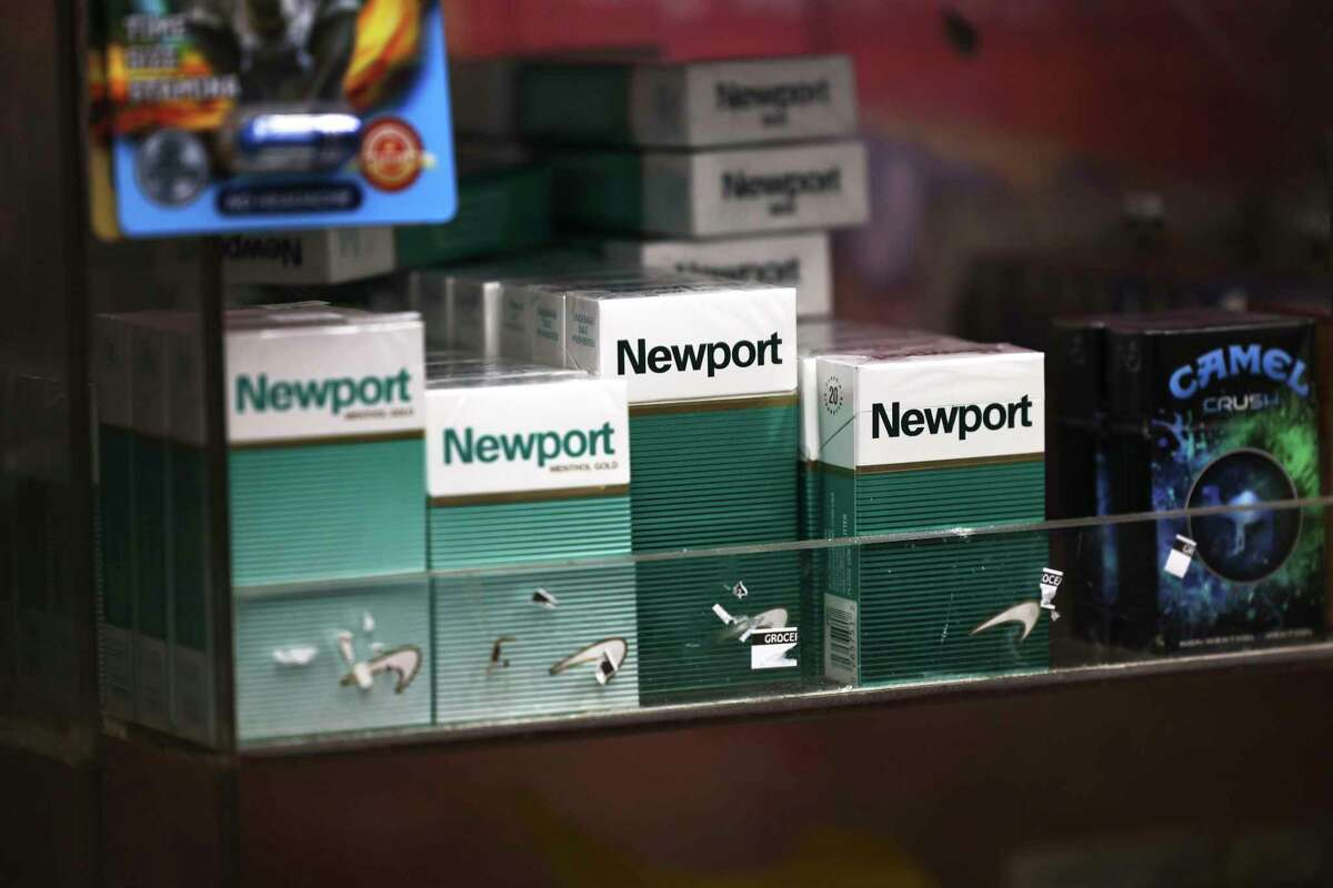 Packs of Newport cigarettes are seen on a shelf in a grocery store in the Flatbush neighborhood on April 29, 2021 in the Brooklyn borough of New York City. The Biden administration announced its plan to ban menthol cigarettes and flavored cigars citing the health reasons that disproportionately affect communities of color and low-income populations who are more likely to use the products. (Michael M. Santiago/Getty Images/TNS)