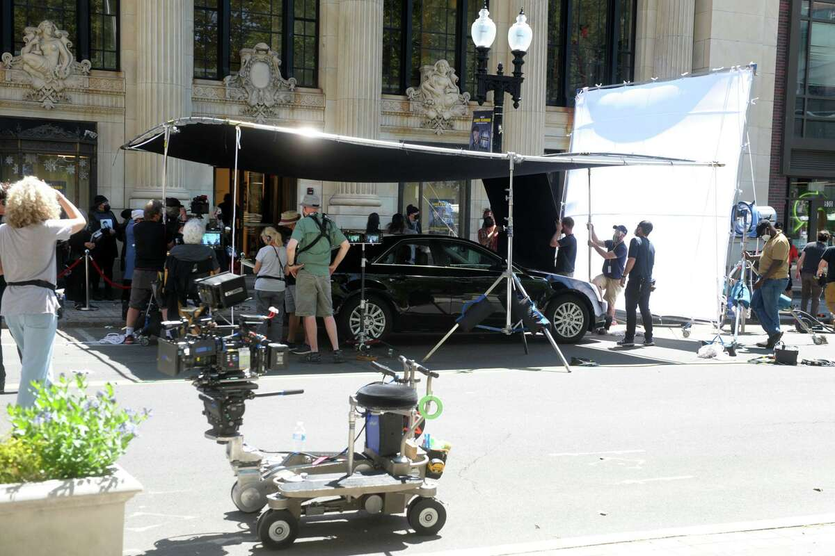 """A crew films a scene for upcoming Netflix movie """"The Noel Diary"""" on Main St. in downtown Bridgeport, Conn. May 27, 2021."""