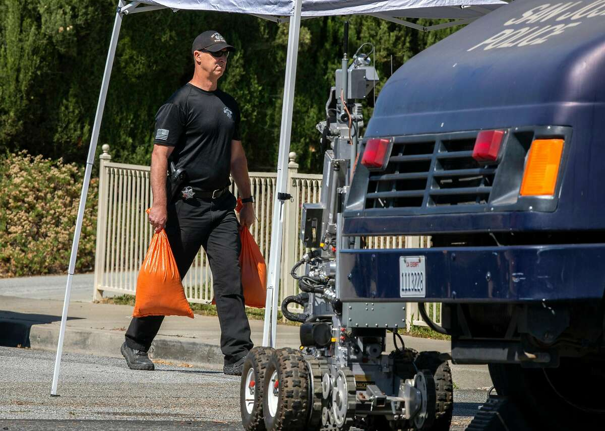 The San Jose bomb squad collects evidence outside the home of Samuel James Cassidy. Evidence collection at various scenes will be time-consuming.