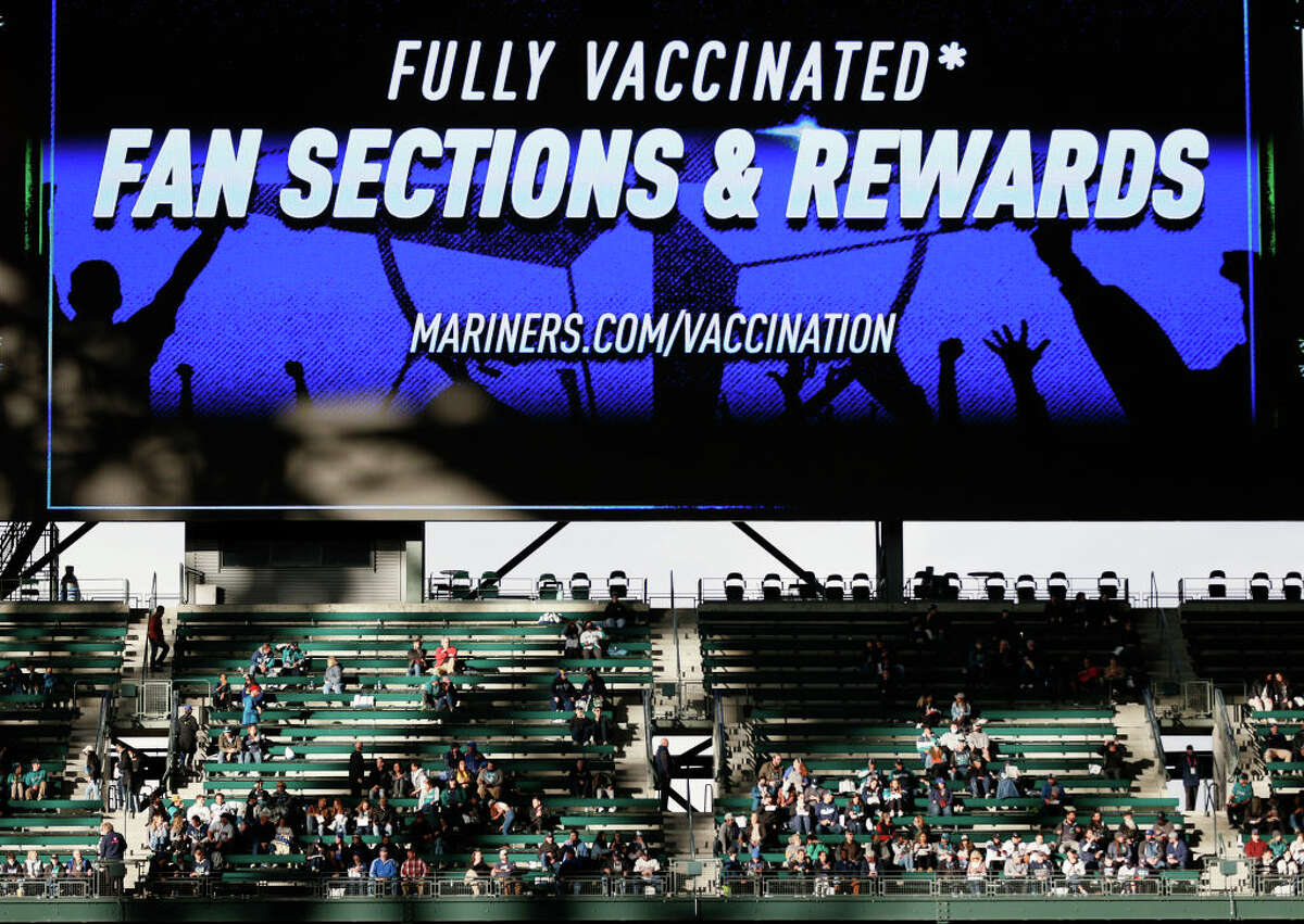 Fans are seen in the outfield bleachers designated for those fully vaccinated during the game between the Seattle Mariners and the Detroit Tigers at T-Mobile Park on May 18, 2021 in Seattle, Washington.