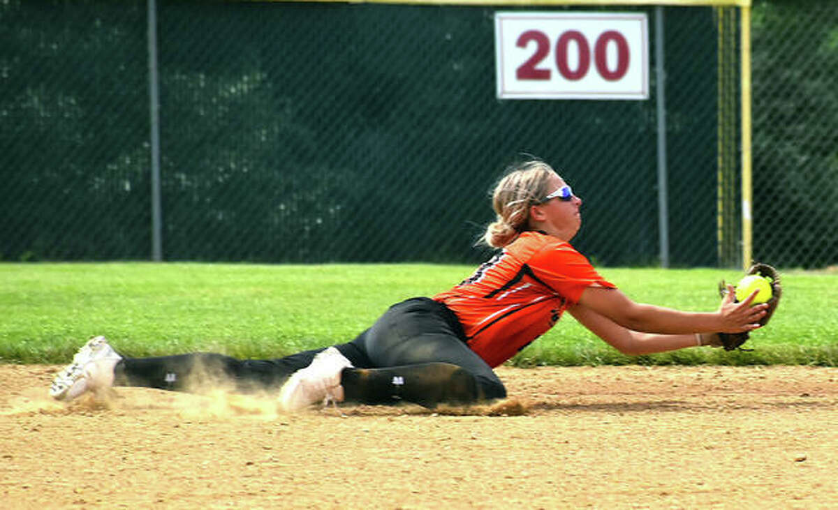 Edwardsville second baseman Lexi Gorniak makes a diving catch to her left to end the fourth inning against Alton.