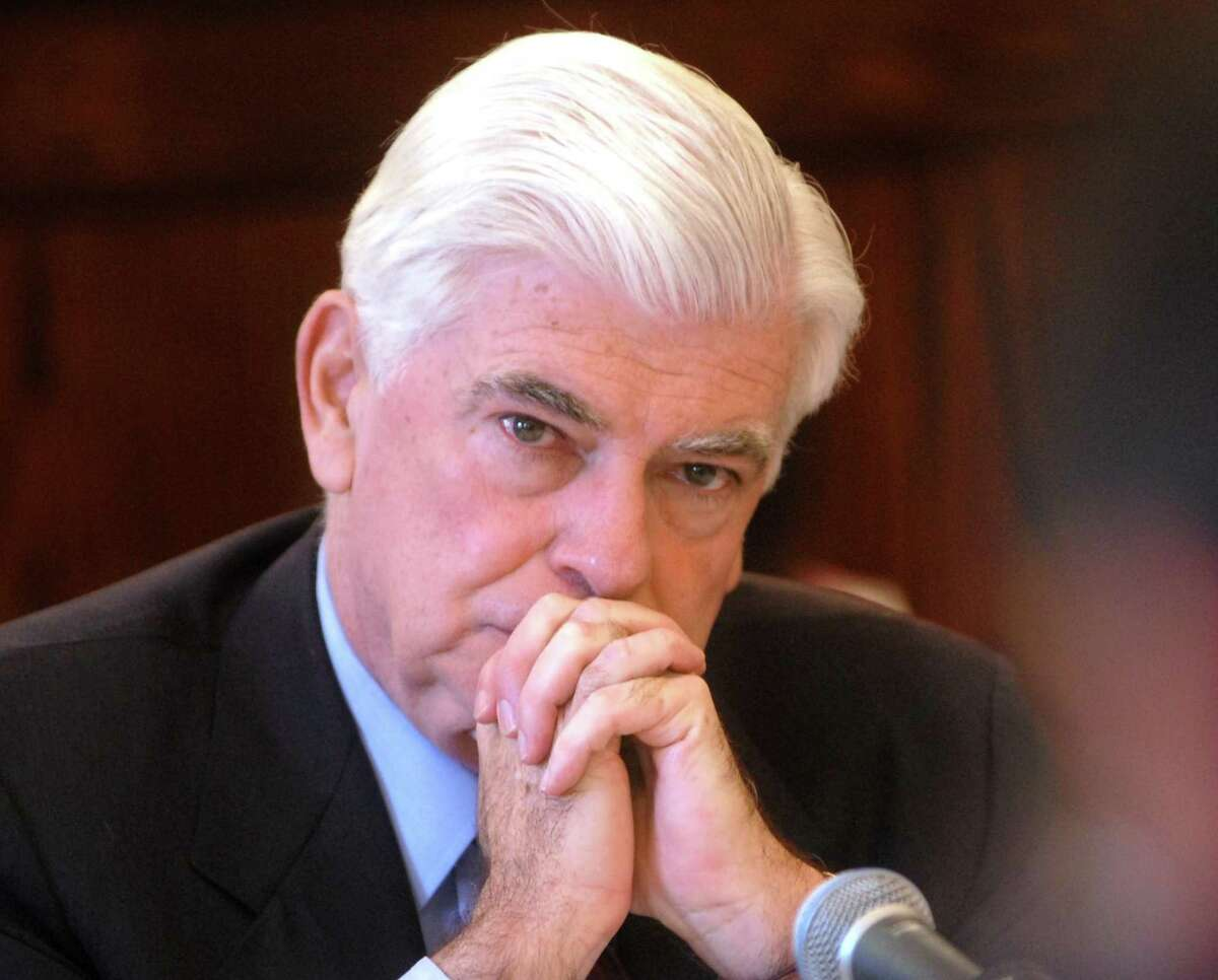 Brad Horrigan | New Haven Register. BH0332. New Haven, Connecticut - 04.16.09: US Senator Chris Dodd listens to a panel member at Thursday's Senate Banking Committee hearing on transit issues at the Hall of Records.
