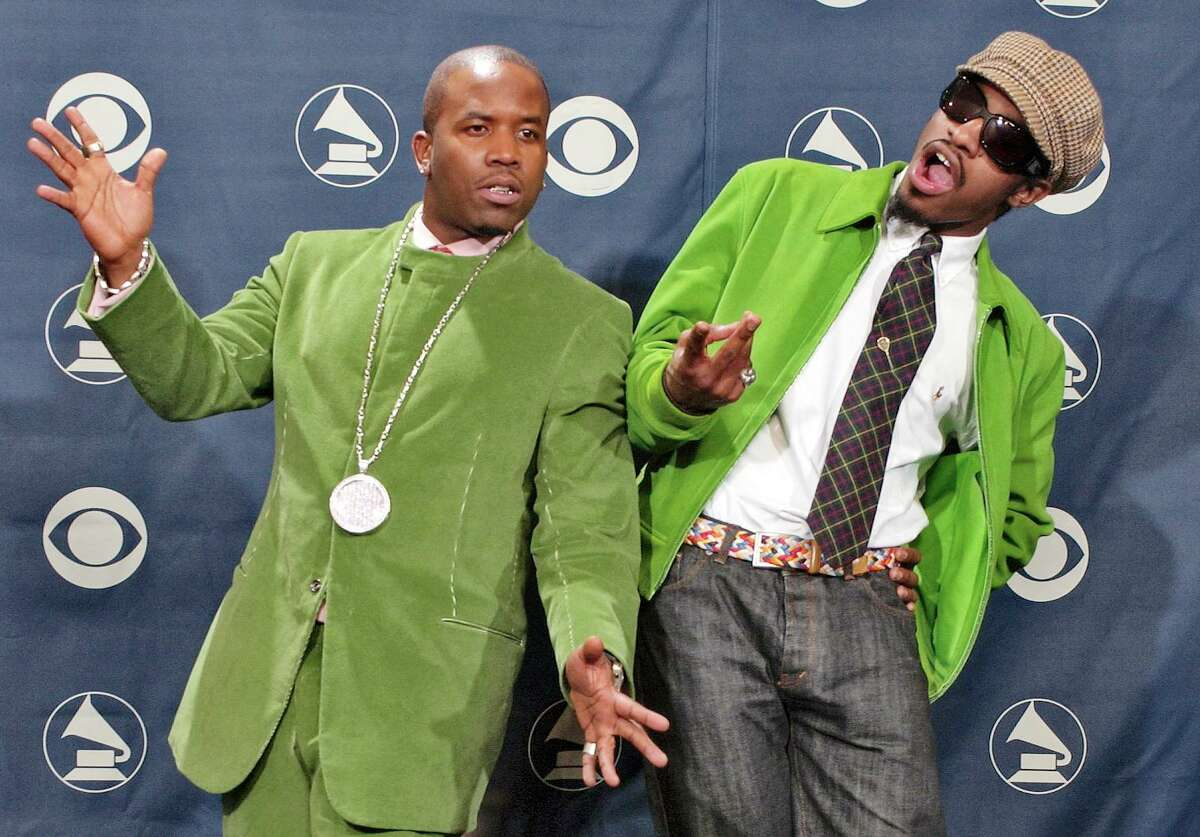 OutKast members Big Boi and Andre 3000 pose in front of the three awards they won at the 46th Annual Grammy Awards, Sunday, Feb. 8, 2004, in Los Angeles. (AP Photo/Reed Saxon)