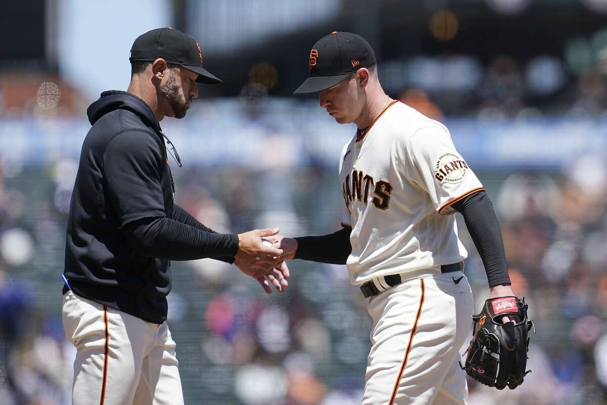 The Giants' Anthony DeSclafani, who gave the ball to manager Gabe Kapler after allowing 10 runs in 2 ?...