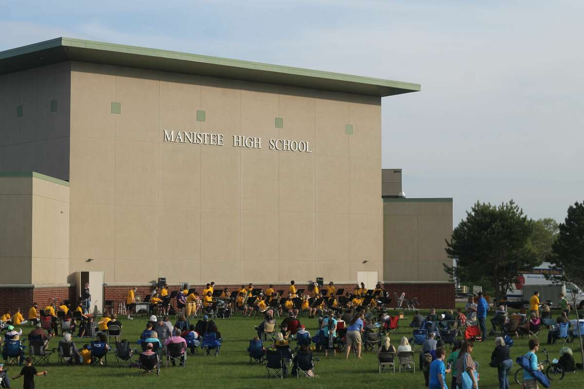 The Manistee High School jazz and symphonic bands, along with the eighth-grade band, played an outdoor concert at the Manistee Middle High School building on Monday evening.