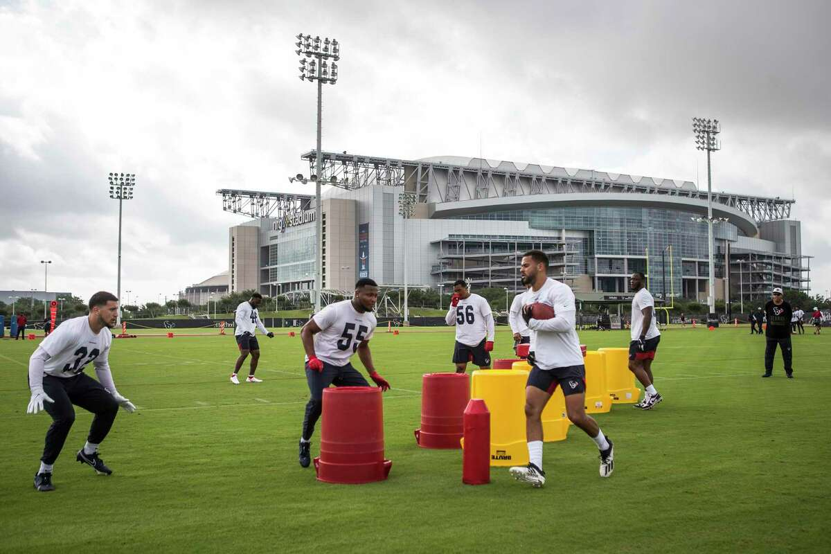 Houston Texans linebackers work out in the shadow of NRG Stadium during team OTAs on Thursday, May 27, 2021, at The Houston Methodist Training Center in Houston.