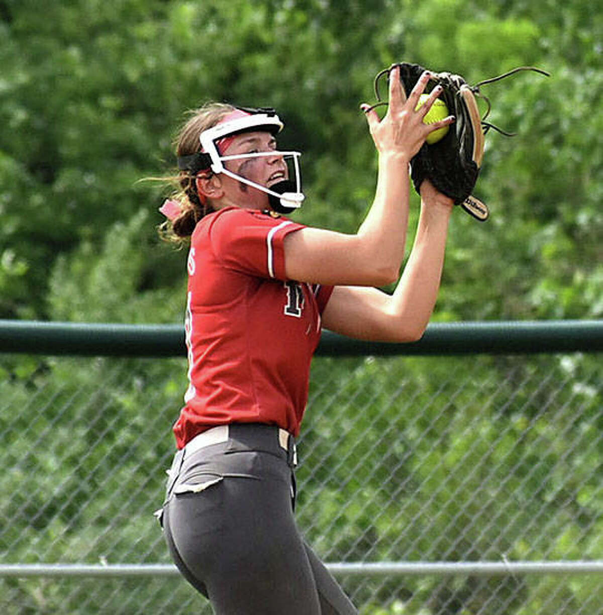 Alton second baseman Alyssa Sauls makes a running catch into short right field for the second out of the sixth inning Thursday morning against Edwardsville at Alton High in Godfrey.