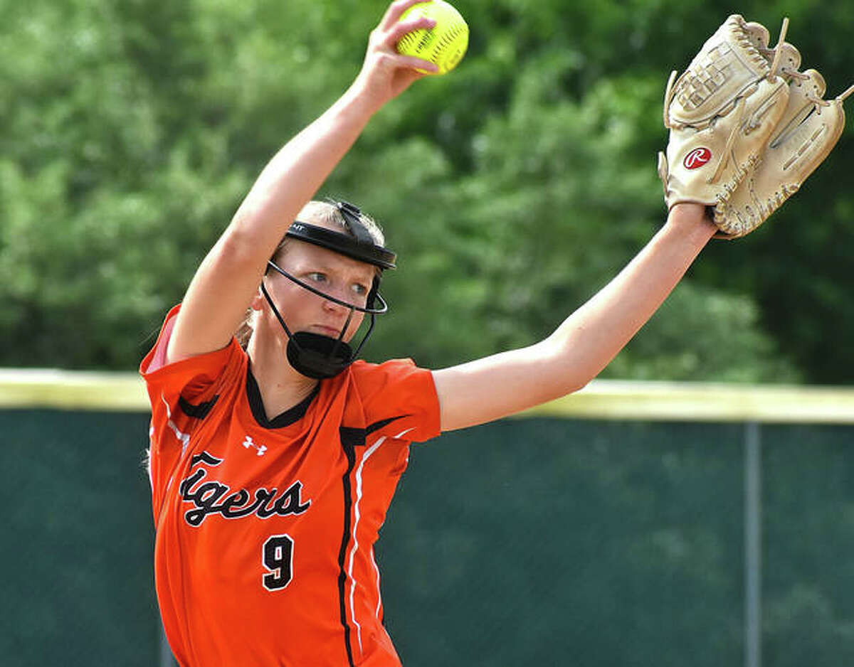 Edwardsville pitcher Avery Hamilton delivers to the plate during her perfect game against Alton in a SWC softball game on Thursday in Godfrey.