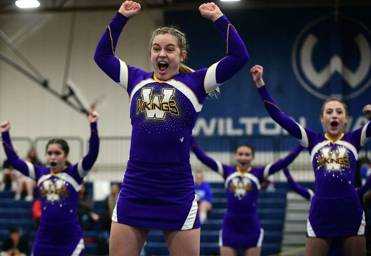 1The Westhill High School cheerleading squad competes during the FCIAC cheerleading championships at Wilton High School in Wilton, Conn.