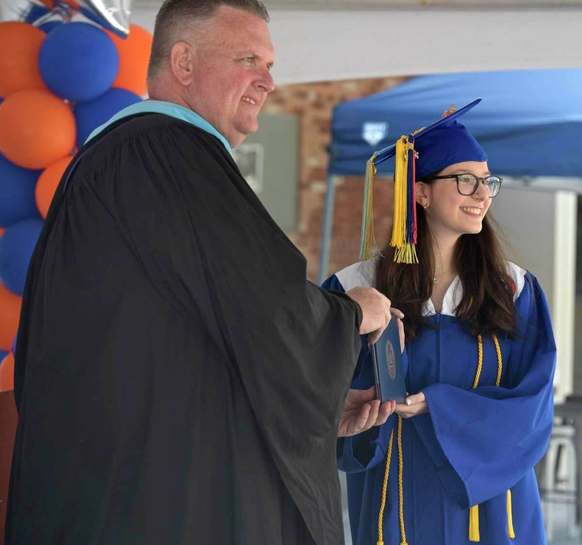 Principal Daniel Donovan posses for a photograph with graduate Rebecca Leigh Andersen during the 2020 Danbury High School graduation, Wednesday, June 10, 2020, at Danbury High School, Danbury, Conn. Graduation is taking place over three days, June 10, 11, and 12.