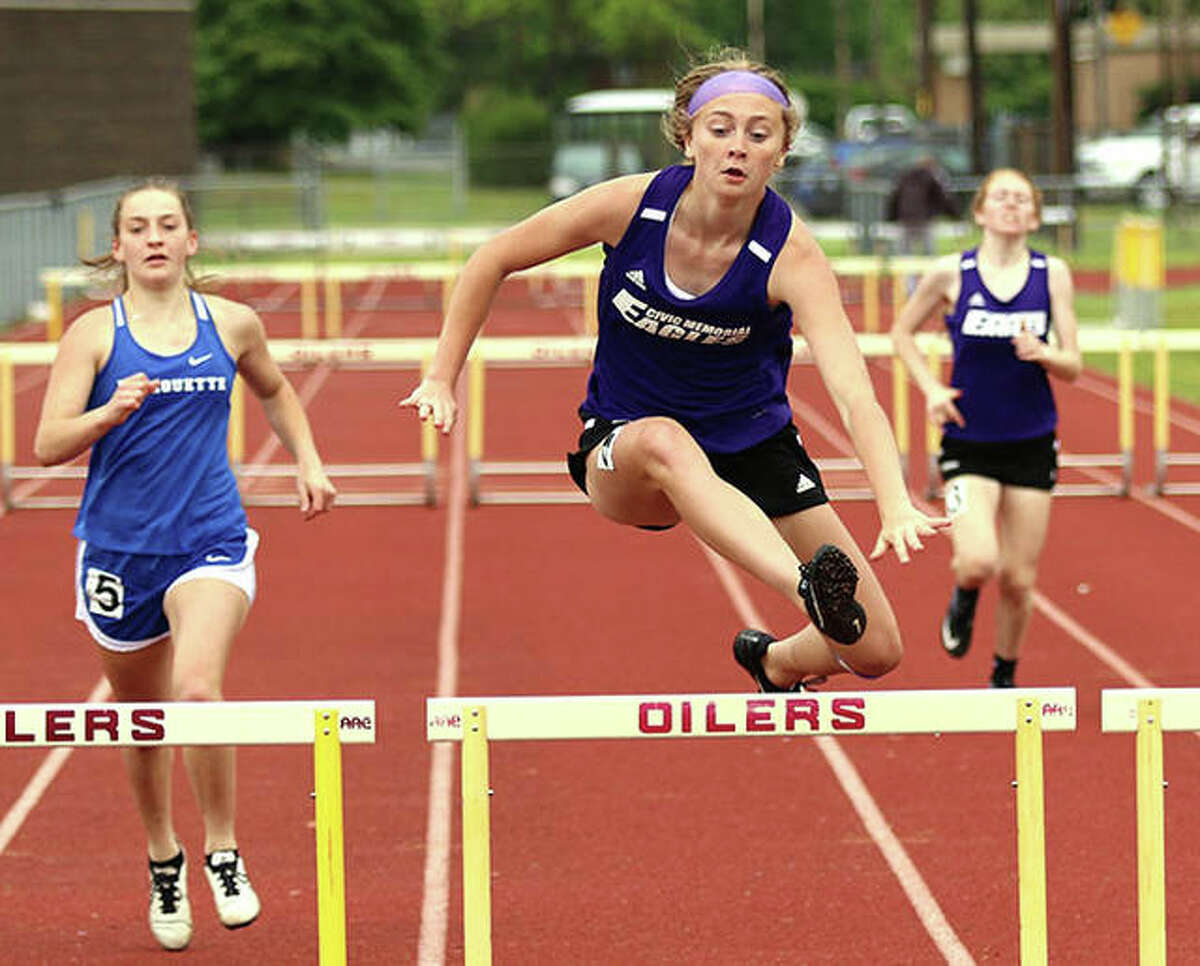 CM's Bella Dugger (middle) clears the final hurdle in the 300-meter hurdles at the Madison County Meet May 17 in Wood River. On Thursday, Dugger won the 100 hurdles and was second in the 300 hurdles at the Mississippi Valley Conference girls track meet in Troy.