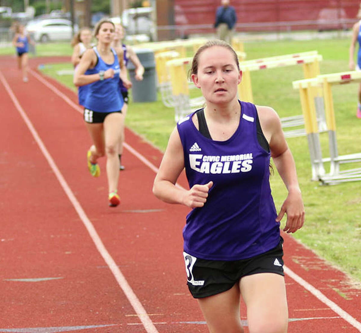 CM's Hannah Meiser (front), shown running the 800 at the Madison County Meet on May 17 in Wood River, won the 1,600 and was runner-up in the 800 on Thursday at the MVC Meet in Troy.
