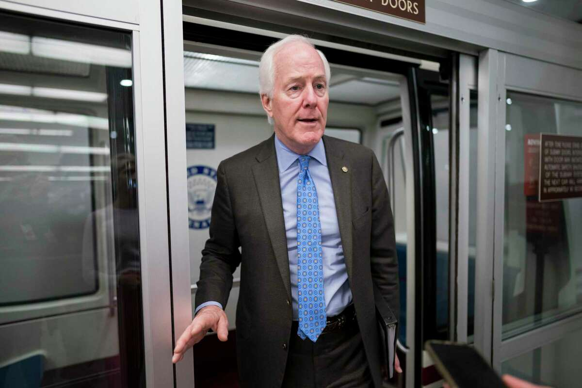 Sen. John Cornyn, R-Texas, pauses for reporters as senators rush to the chamber for votes ahead of the approaching Memorial Day recess at the Capitol in Washington, D.C., on Wednesday, May 26.