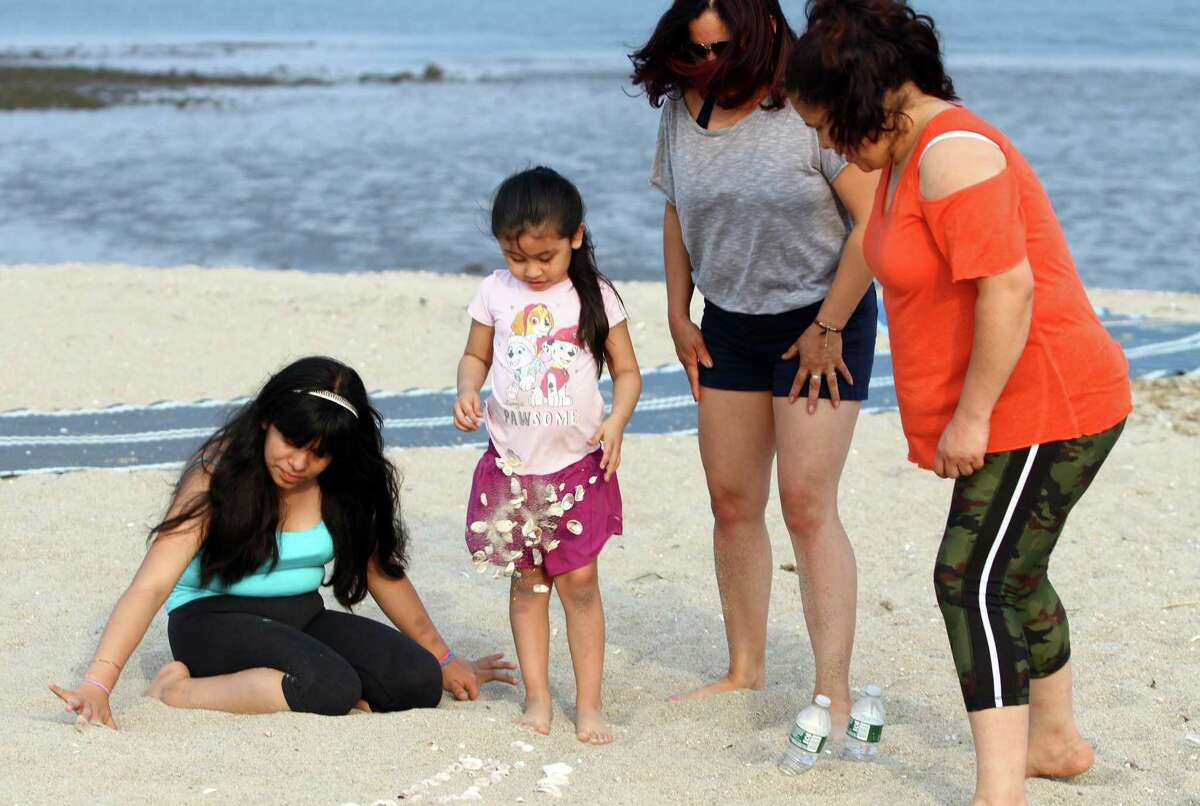 Ahead of the Memorial Day weekend, residents enjoy Cummings Beach in Stamford, Conn., on Wednesday May 26, 2021.