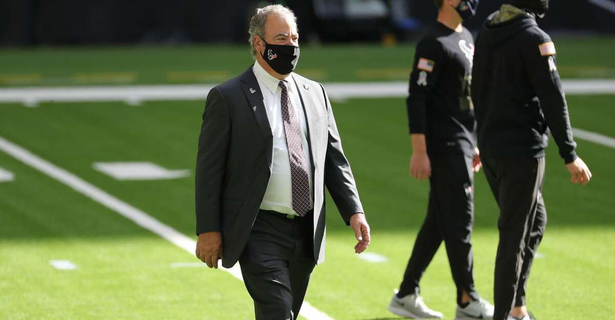 Houston Texans CEO Cal McNair walks on the field before an NFL football game against the New England Patriots at NRG Stadium on Sunday, Nov. 22, 2020, in Houston.