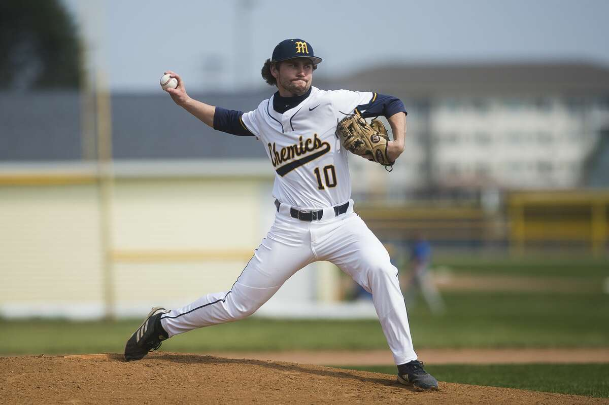 Midland High's Al Money delivers a pitch during an April 8, 2021 game against Traverse City West.