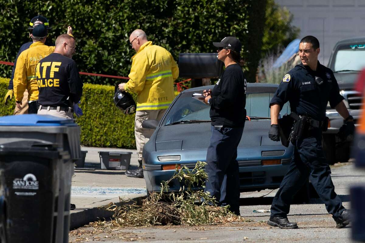Alcohol, Tobacco and Firearms officers along with with San Jose fire and police officials outside the home of Samuel James Cassidy on Thursday after the mass shooting at a Valley Transportation Authority light-rail yard.