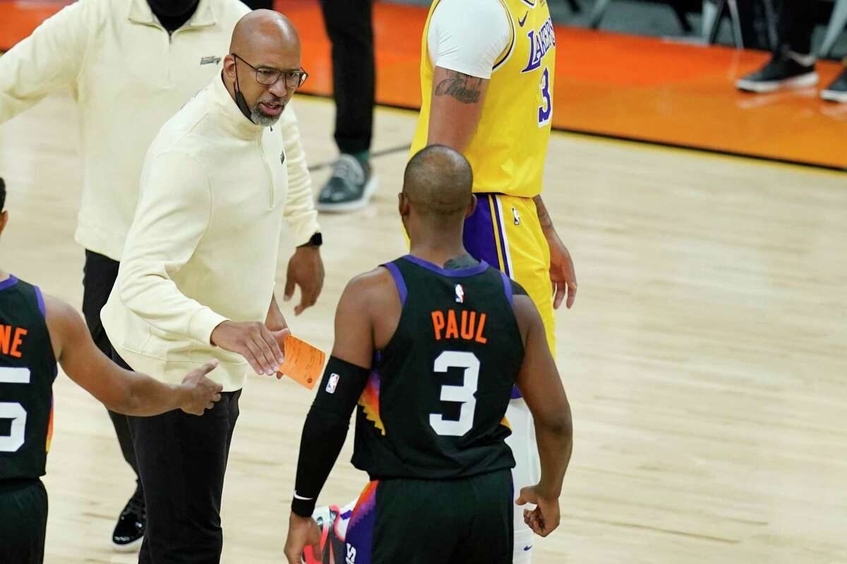 Phoenix Suns head coach Monty Williams, left, celebrates with Suns guard Chris Paul (3) after Paul scored against the Los Angeles Lakers during the first half of Game 2 of their NBA basketball first-round playoff series Tuesday, May 25, 2021, in Phoenix. (AP Photo/Ross D. Franklin)