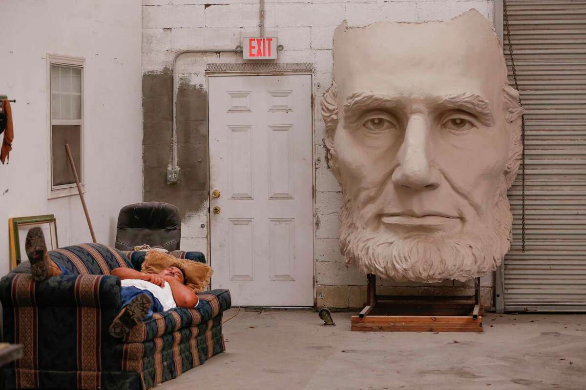 The face of David Adickes' President Abraham Lincoln is next to an exit door at his warehouse Tuesday, May 18, 2021, in Houston.