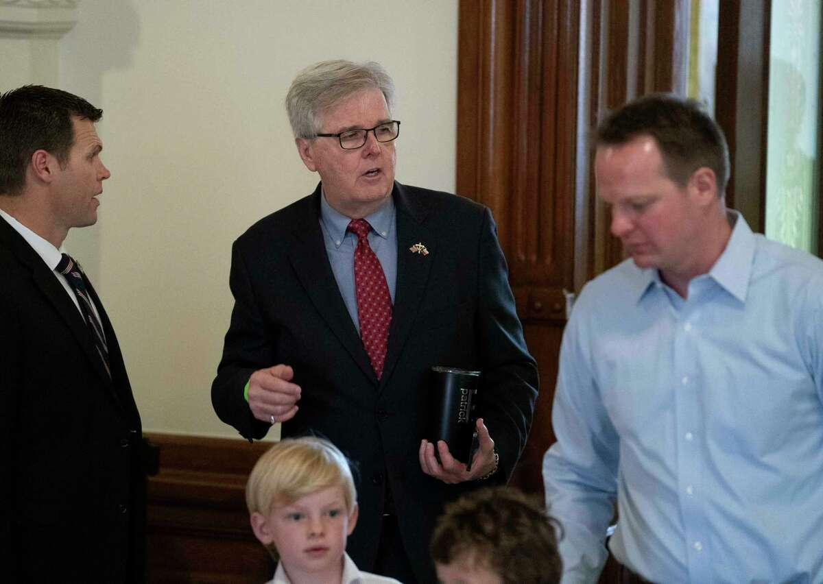 Lt. Gov. Dan Patrick leaves a meeting room outside the Senate chamber in Austin with his son-in-law Jared Scruggs, r, as the chamber works to clear a backlog of bills before Monday's end of the session. (Bob Daemmrich/CapitolPressPHoto)
