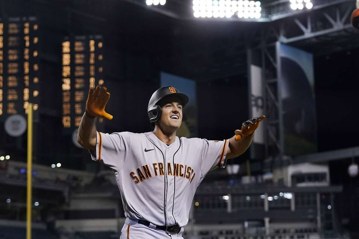 San Francisco Giants' Jason Vosler smiles as he celebrates his home run against the Arizona Diamondbacks during the eighth inning of a baseball game Wednesday, May 26, 2021, in Phoenix. (AP Photo/Ross D. Franklin)