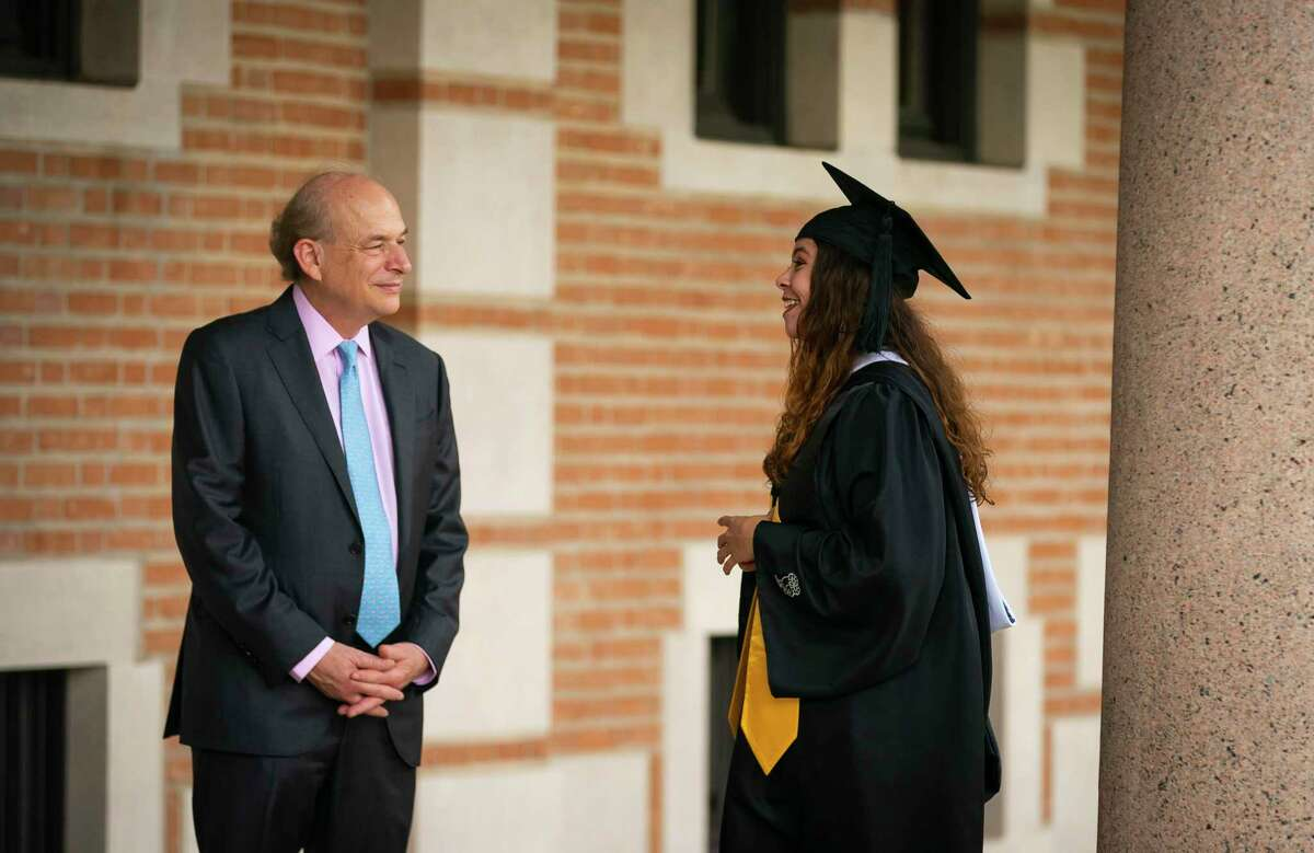 Rice University President David Leebron talks with recent graduate Citlali Villarreal, Wednesday, May 26, 2021, on the campus of Rice University in Houston. Villarreal, who just graduated with a degree in ecology and evolutionary biology, was on campus taking celebratory photos with her family when she ran across President Leebron. Leebron announced Wednesday that he will step down from his position in June 2022. His tenure at the college makes him the second-longest president following Rice's founding president, Edgar Odell Lovett, who held the position for 34 years.