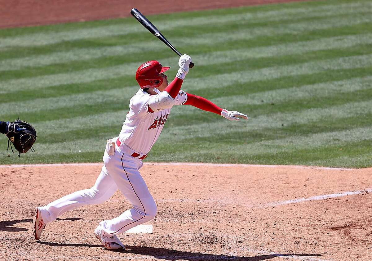 ANAHEIM, CALIFORNIA - MAY 26: Shohei Ohtani #17 of the Los Angeles Angels runs to first on an infield single during the sixth inning of a game against the Texas Rangers at Angel Stadium of Anaheim on May 26, 2021 in Anaheim, California. (Photo by Sean M. Haffey/Getty Images)