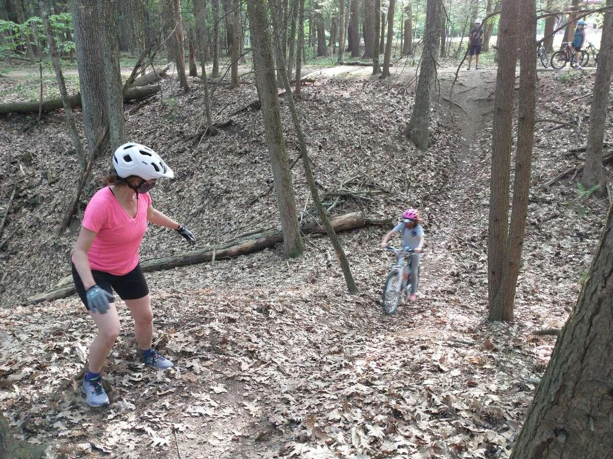 A mentor coaches a Shredder up a hill during a recent ride.