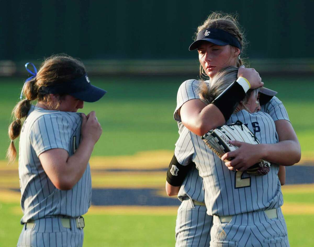 Lake Creek pitcher Emiley Kennedy comforts Maddie Mckee after Reagan Duty's walk-off single in the eighth inning gave Barbers Hill a 6-5 win over the Lions in Game 2 of a Region III-5A final series at Cypress Ranch High School, Thursday, May 27, 2021, in Cypress.