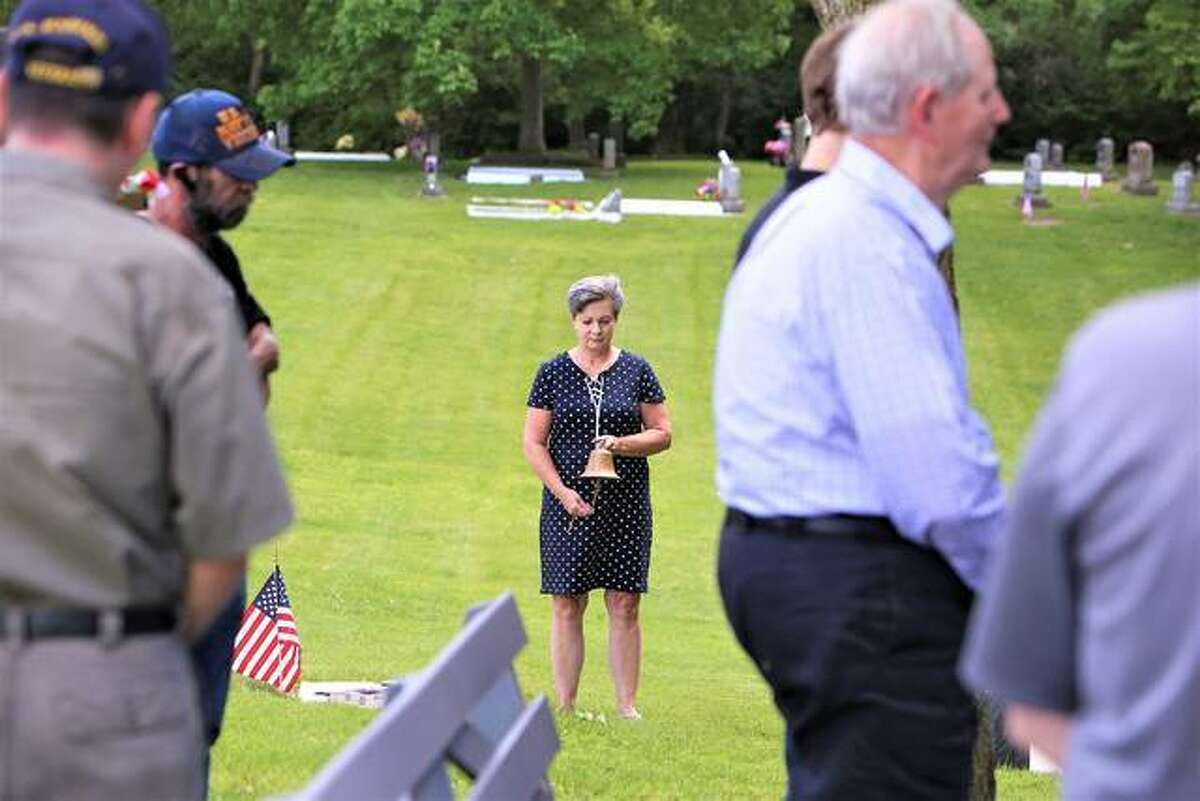 Wanda Todoroff rings a bell twenty-one times during a reenactment of the Bells of Peace honorarium to World War I. The event was held on Memorial Day 2019 at Buck Road Cemetery in Maryville for the hundredth anniversary of the WWI armistice.