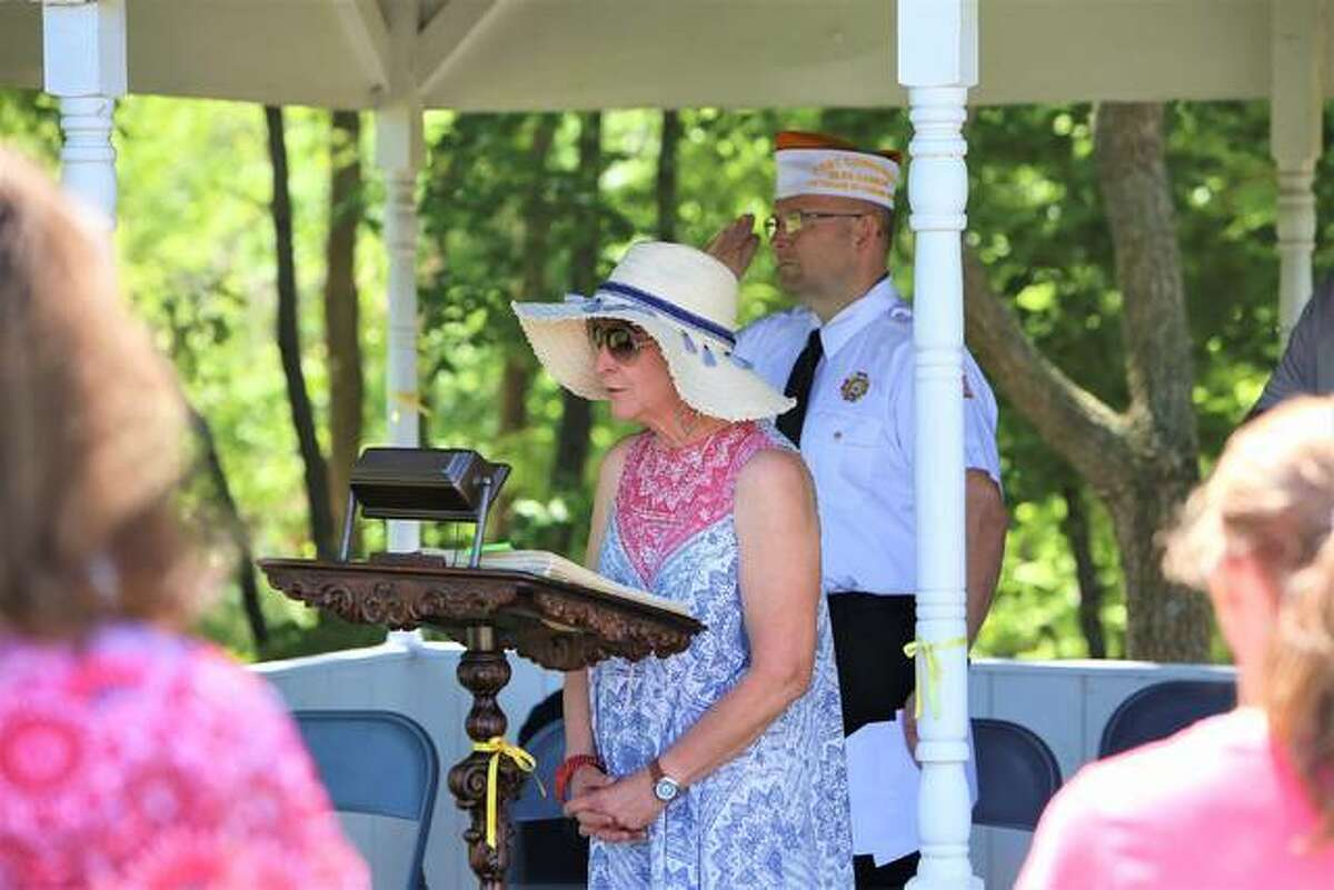 Martha Brockus sings the national anthem while at the Memorial Day observance at Buck Road Cemetery in Maryville in 2019.