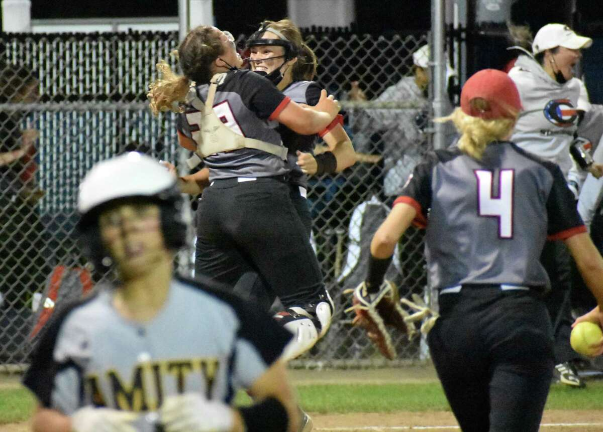 Cheshire pitcher Bri Pearson and catcher Trinadey Santiago celebrated after winning the SCC softball championship, 5-4 over Amity at Biondi Field, West Haven on Thursday, May 27, 2021.