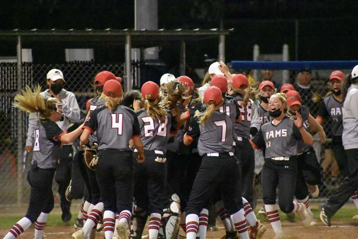 Cheshire players celebrate after beating Amity in the SCC championship game on Thursday at Biondi Field in West Haven.