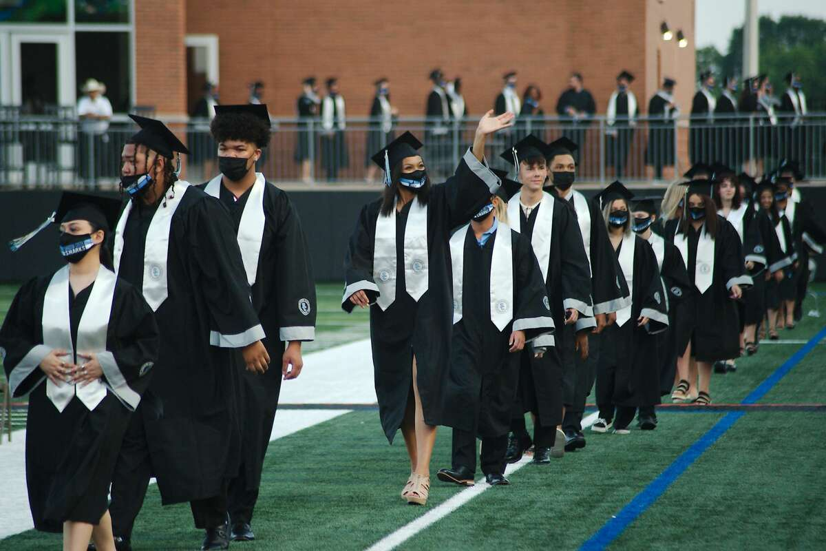 Shadow Creek High School graduating seniors march into Alvin ISD Freedom Field for graduation Thursday, May 27.
