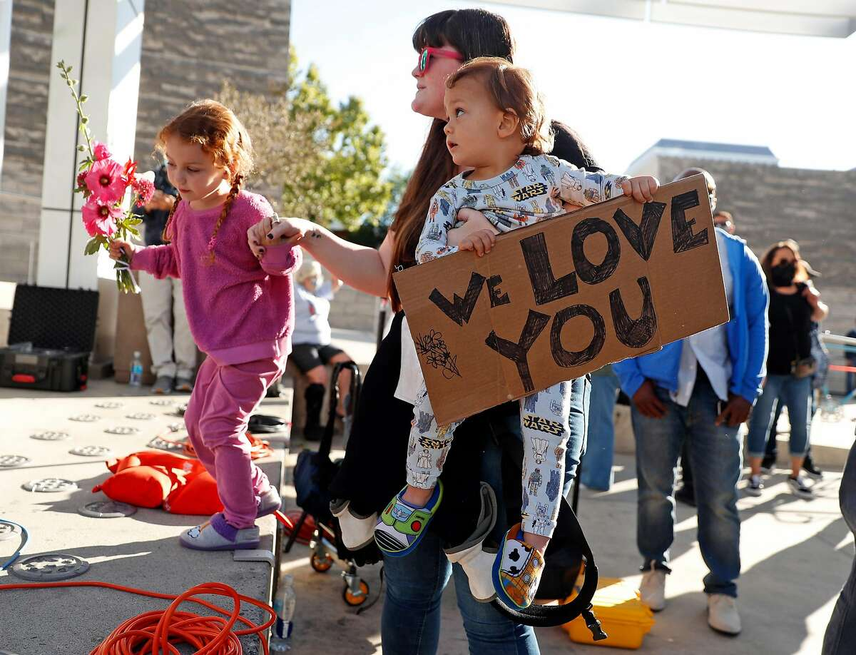 Jenny Zeroun and her children, Charley, 3, and Deacon, 2, attend a public vigil on Thursday, May 27, 2021, at San Jose City Hall for victims of Wednesday's mass shooting at Valley Transportation Authority's maintenance yard in San Jose, Calif..