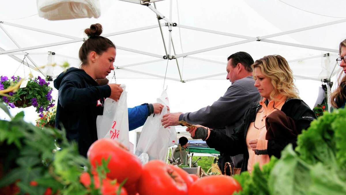 Vendors sell goods to residents at the Port Austin Farmers Market back in 2019. (Tribune File Photo)