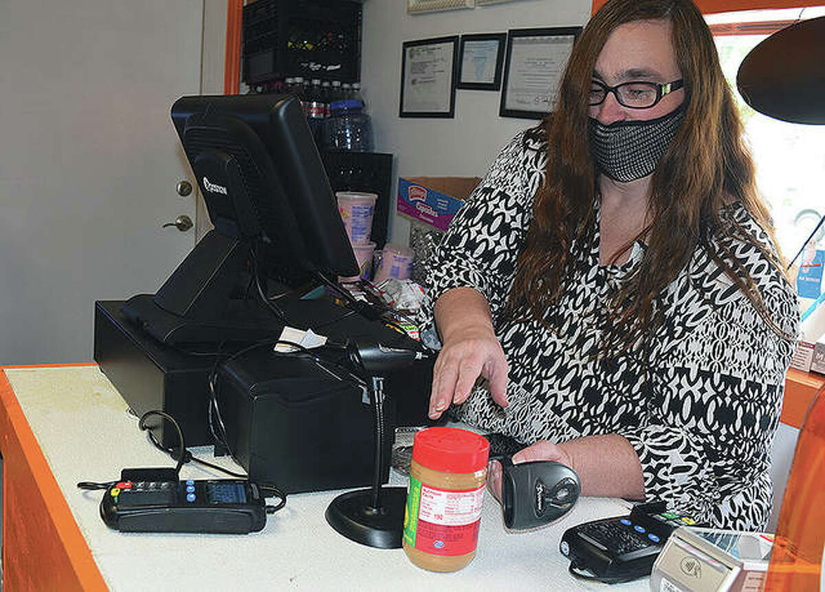LeAnn Tyler, president of Fresh Start, scans items at Fresh Start Convenience Store at 600 N. Clay Ave. The store will be open 24 hours and carry items including food, lottery tickets, liquor, firewood, tobacco products, car accessories and some household products.