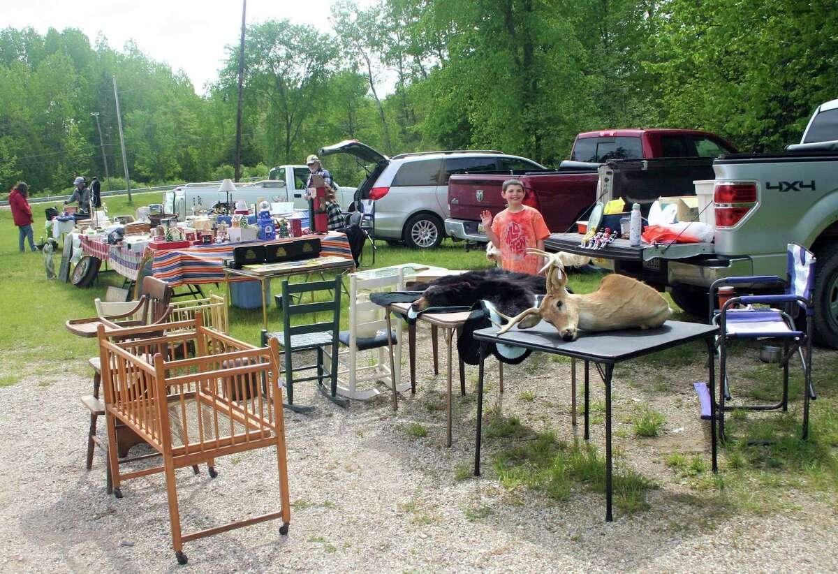Vendors set up at the Paris FarmersMarket on opening day Thursday with gently used items for resale along with original handmade items, produce and food products. (Pioneer photo/Cathie Crew)