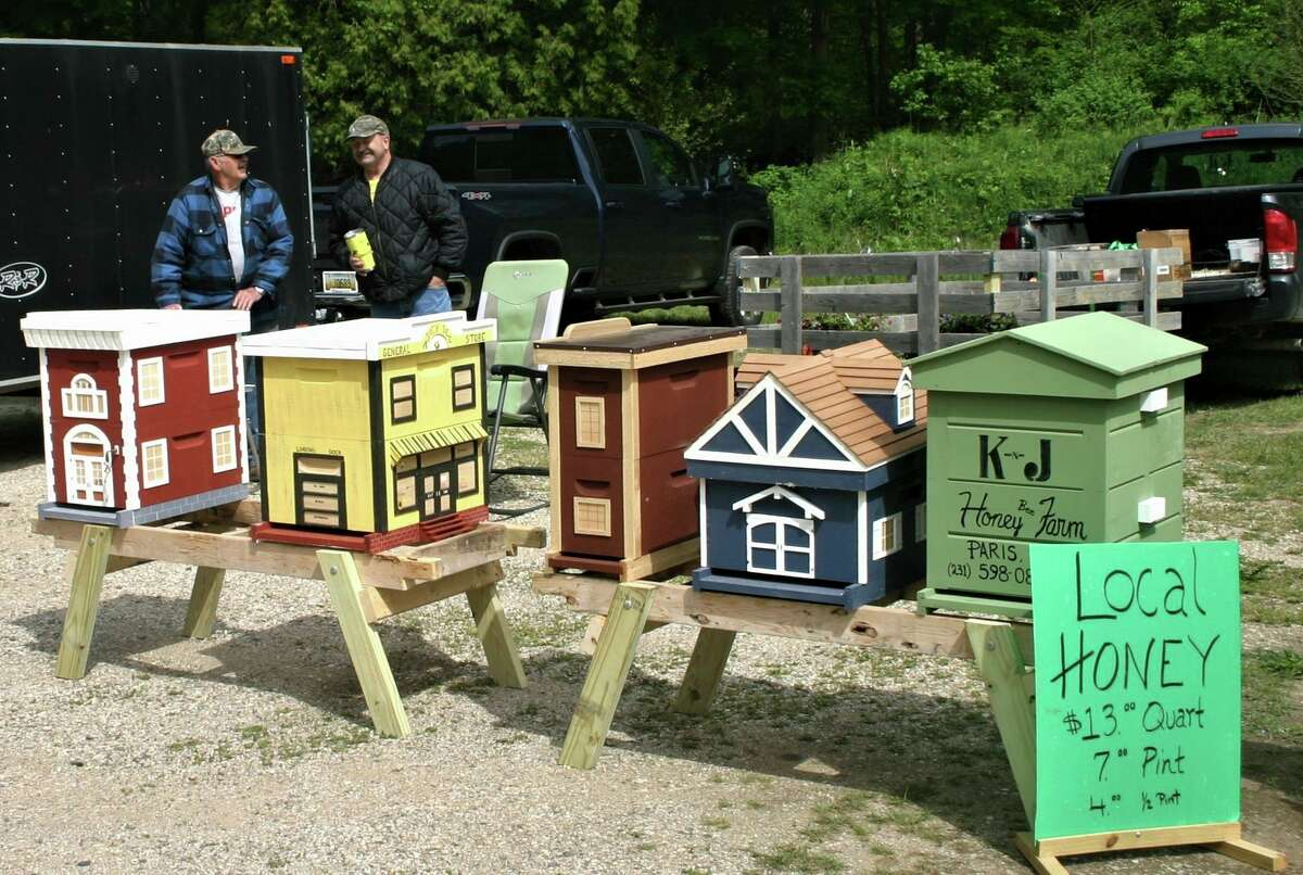 The Paris Farmers Market offers these handmade decorative beehives, as well as local harvested honey for sale. (Pioneer photo/Cathie Crew)