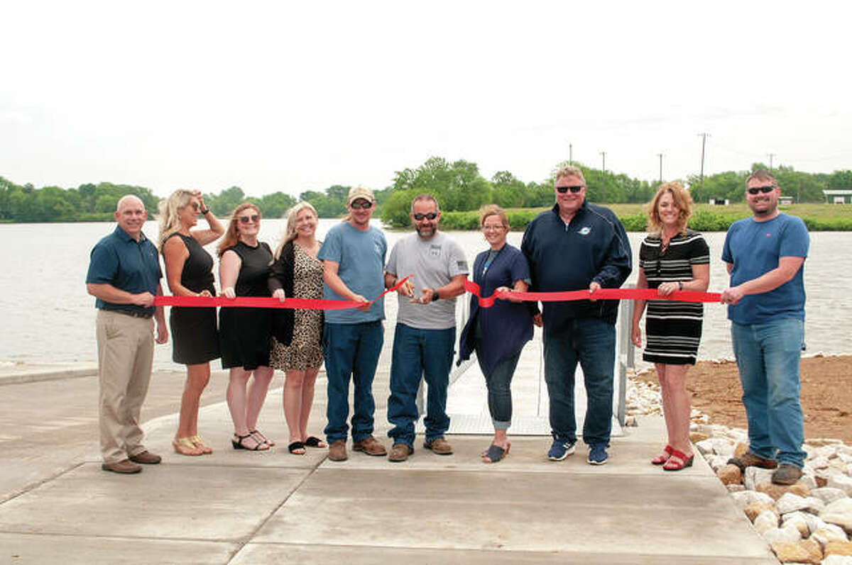 The Lake Mauvaisterre boat ramp was officially opened Thursday with a ribbon-cutting ceremony. Jim Burke (from left), Kristin Jamison, Brittany Henry, Eren Williams, Bryce Ballenger, Brett Gilbreth, Lori Oldenettel, Jacksonville Mayor Andy Ezard, Lisa Musch and Adam Fletcher were on hand for the occasion. The ramp and a dock on the south side of the lake, both of which were funded by a state grant, cost $200,000.