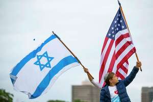 Supporters of Israel hold a rally supporting May 23, 2021 in Houston.