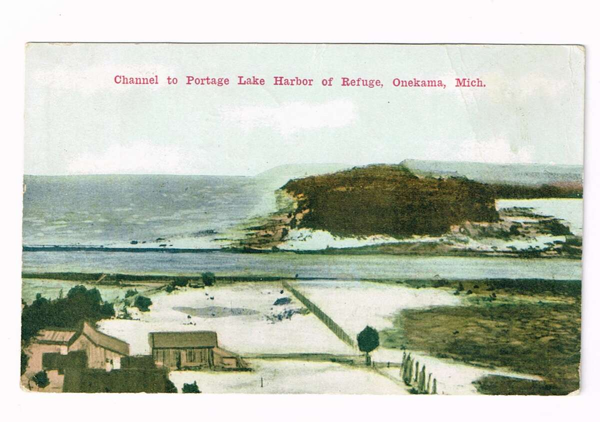 Channel to the Portage Lake harbor of refuge in Onekama, circa 1912. (Courtesy photo)
